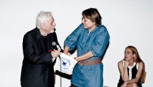 Jodorowsky hands Majewski the gold ingots. Photography: Oliver Helbig