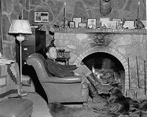 John Joseph Matthews (c. 1894-1979) in front of his fireplace
